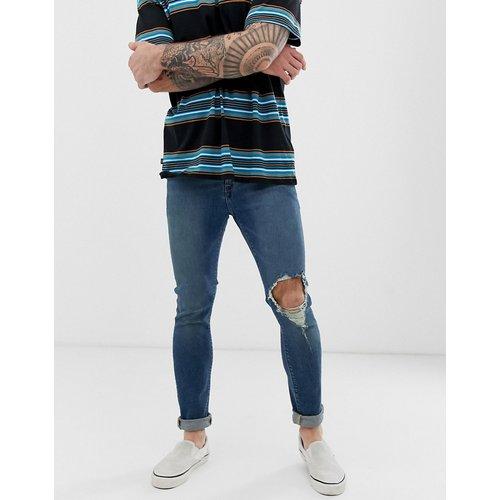 Jean super skinny à genou déchiré - délavé moyen - ASOS DESIGN - Modalova