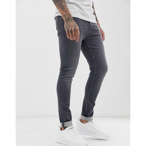 Jean super skinny - délavé foncé - ASOS DESIGN - Modalova