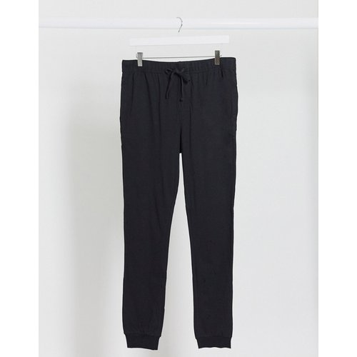 Joggers de pyjama confort - ASOS DESIGN - Modalova