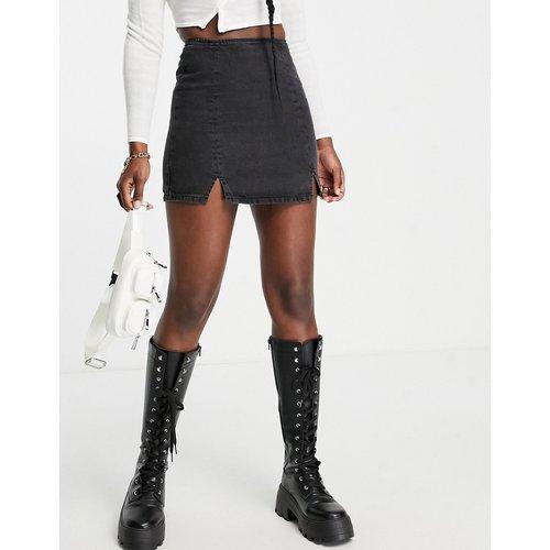 Mini-jupe en jean fendue - délavé - ASOS DESIGN - Modalova