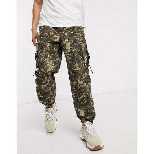 Pantalon cargo large à imprimé camouflage - ASOS DESIGN - Modalova