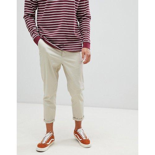 Pantalon chino ajusté court - ASOS DESIGN - Modalova
