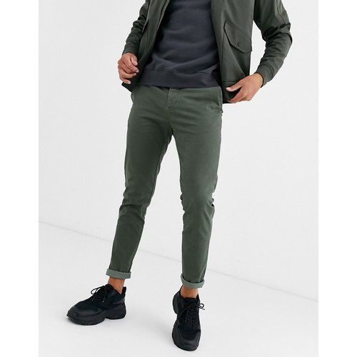 Pantalon chino ajusté - Kaki délavé - ASOS DESIGN - Modalova