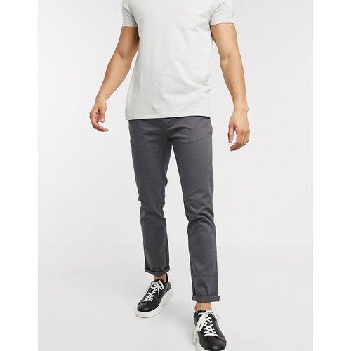 Pantalon chino ajusté - Noir délavé - ASOS DESIGN - Modalova