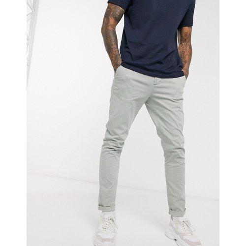 Pantalon chino ajusté - délavé - ASOS DESIGN - Modalova