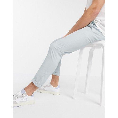 Pantalon chino court ajusté - clair - ASOS DESIGN - Modalova