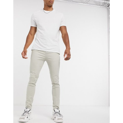 Pantalon chino en power stretch - ASOS DESIGN - Modalova