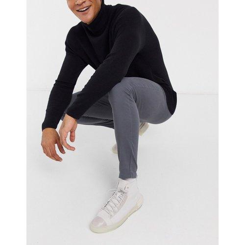 Pantalon chino en power stretch - foncé - ASOS DESIGN - Modalova