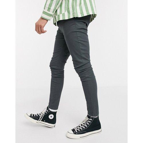 Pantalon chino en tissu power stretch - Noir délavé - ASOS DESIGN - Modalova