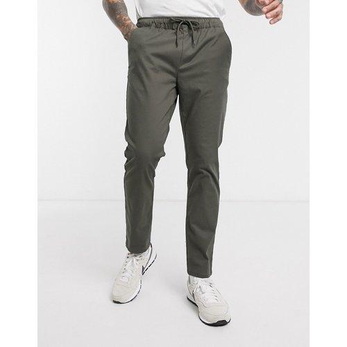 Pantalon chino slim à taille élastique - Kaki - ASOS DESIGN - Modalova