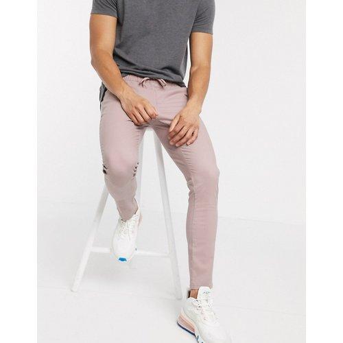 Pantalon chino super ajusté à taille élastique - chaleureux - ASOS DESIGN - Modalova