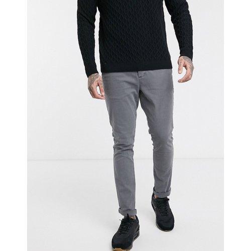 Pantalon chino super ajusté - délavé - ASOS DESIGN - Modalova