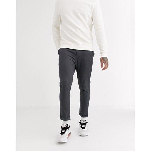 Pantalon chino super ajusté - foncé - ASOS DESIGN - Modalova
