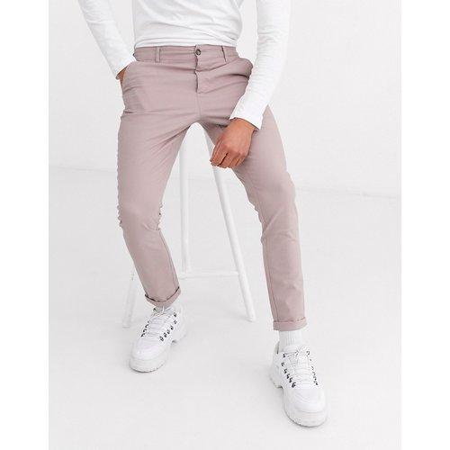 Pantalon chino super ajusté - chaleureux - ASOS DESIGN - Modalova