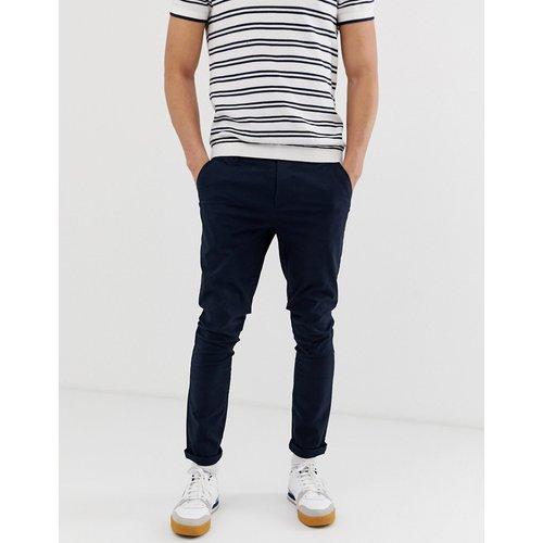 Pantalon chino ultra ajusté - Bleu marine - ASOS DESIGN - Modalova