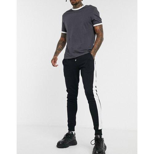 Pantalon de jogging ajusté avec bande latérale - ASOS DESIGN - Modalova
