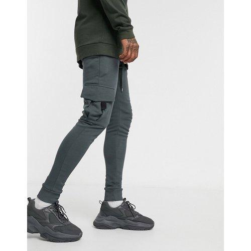 Pantalon de jogging ajusté avec poche cargo - délavé - ASOS DESIGN - Modalova