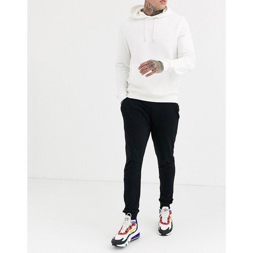 Pantalon de jogging ajusté léger - ASOS DESIGN - Modalova