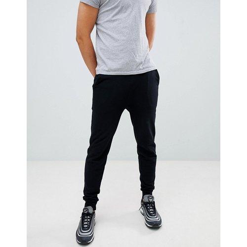 Pantalon de jogging ajusté - ASOS DESIGN - Modalova