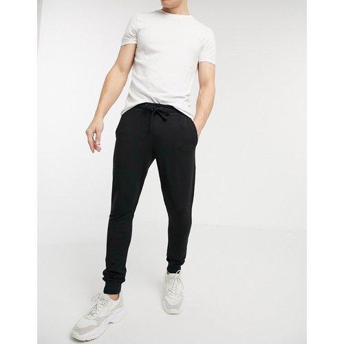 Pantalon de jogging ultra ajusté - ASOS DESIGN - Modalova