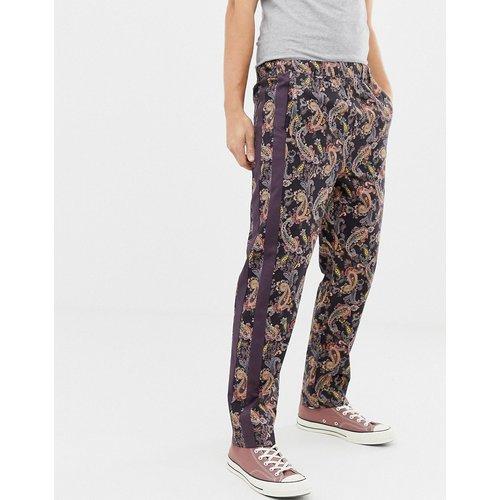 Pantalon décontracté à imprimé cachemire et bande sur le côté - ASOS DESIGN - Modalova