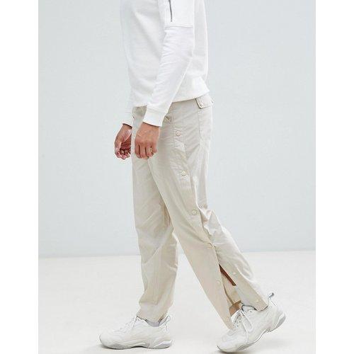 Pantalon décontracté avec boutons-pression sur le côté - ASOS DESIGN - Modalova