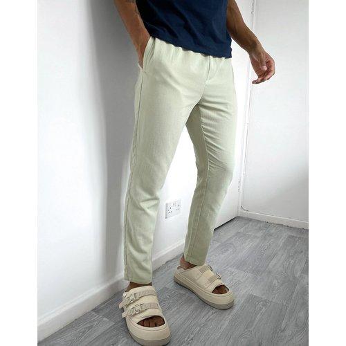 Pantalon slim en tissu texturé - ASOS DESIGN - Modalova