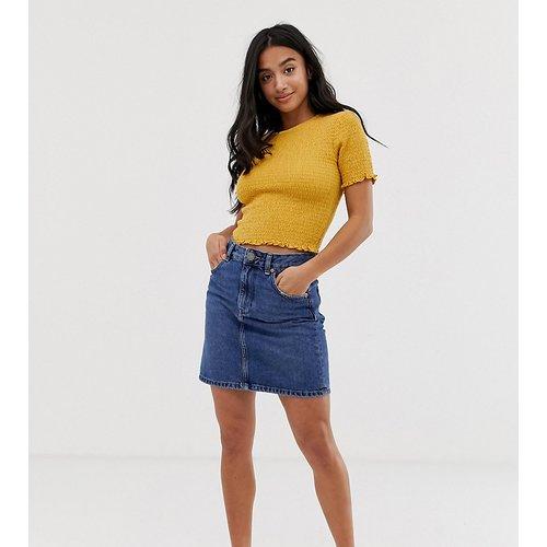 ASOS DESIGN Petite - Jupe taille haute en jean authentique - moyen délavé - ASOS Petite - Modalova