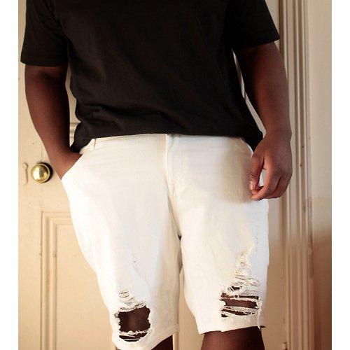 Plus - Short skinny en jean avec déchirures effet échelle - ASOS DESIGN - Modalova