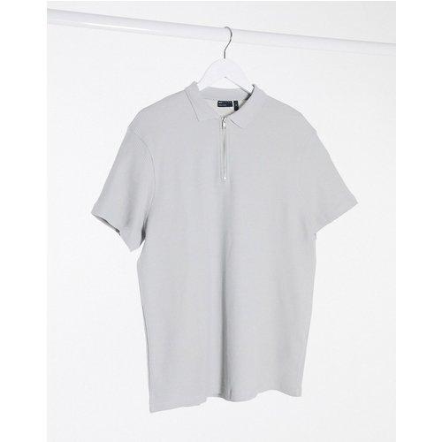 Polo manches courtes en tissu gaufré avecfermeture éclair - ASOS DESIGN - Modalova
