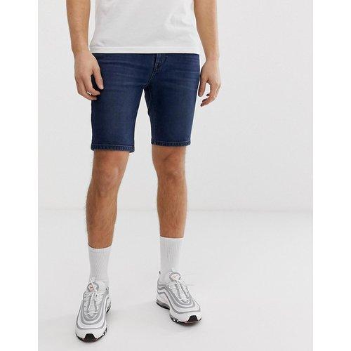 Short en jean skinny - Délavage foncé - ASOS DESIGN - Modalova