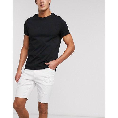 Short skinny en jean avec déchirures - ASOS DESIGN - Modalova