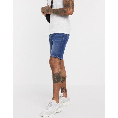 Short skinny en jean - foncé délavé - ASOS DESIGN - Modalova