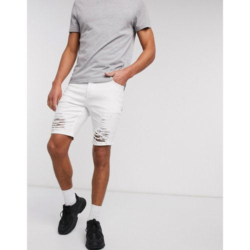 Short skinnyen jean avec déchirures motif échelle - ASOS DESIGN - Modalova
