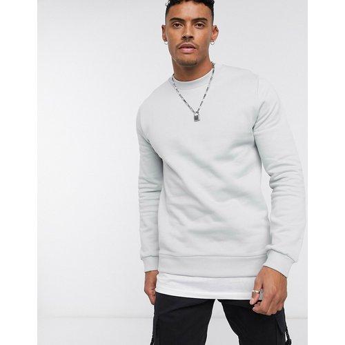 Sweat-shirt à ourlet style t-shirt - ASOS DESIGN - Modalova