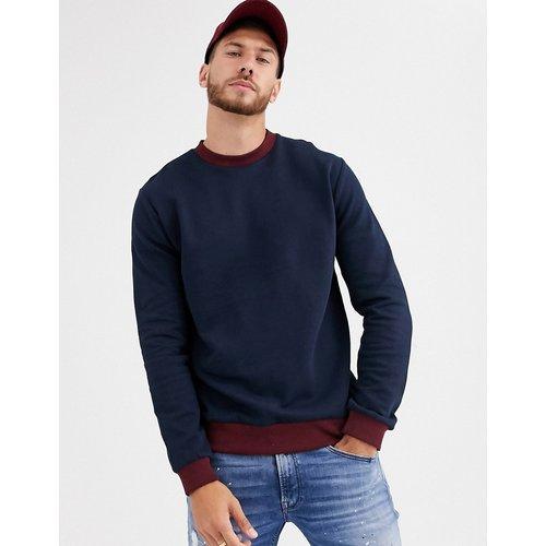 Sweat-shirt avec bords-côtes rouges - Bleu marine - ASOS DESIGN - Modalova