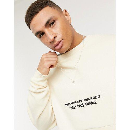 Sweat-shirt oversize avec empiècement en envers polaire imprimé - Blanc cassé - ASOS DESIGN - Modalova