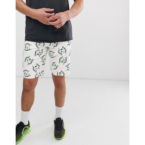Vacation - Short en jean ajusté imprimé - ASOS DESIGN - Modalova