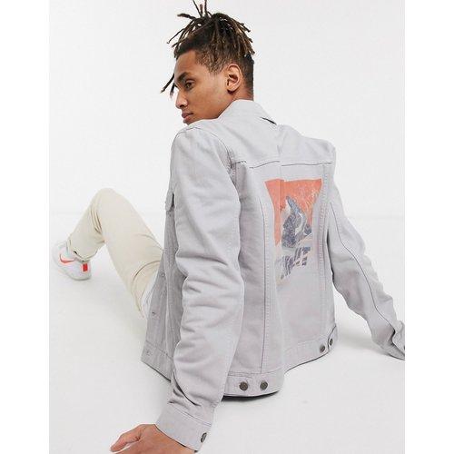Veste en jean imprimée dans le dos - ASOS DESIGN - Modalova