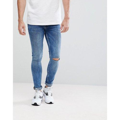 ASOS - Jean extreme skinny avec déchirures aux genoux - Délavage moyen vintage - ASOS DESIGN - Modalova
