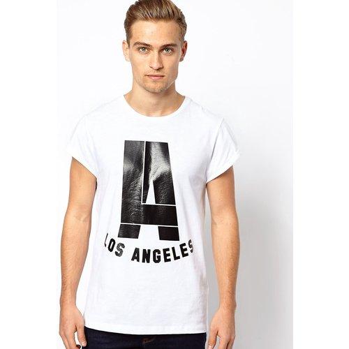 ASOS - T-shirt à imprimé « LA » brillant et manches à revers - ASOS DESIGN - Modalova