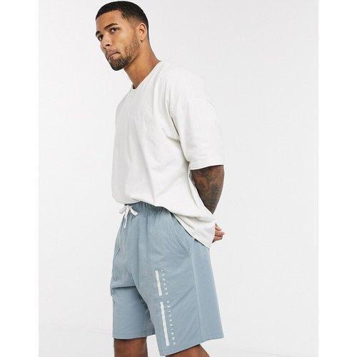ASOS - Unrvlld Supply - Ensemble pyjama confort avec t-shirt et short nervuré - ASOS Unrvlld Supply - Modalova