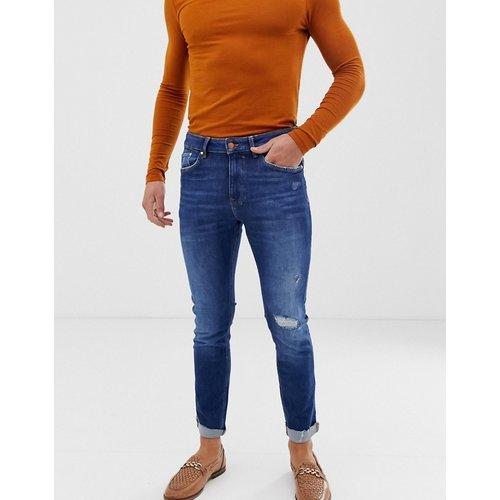 Join Life - Jean skinny en coton bio avec déchirures aux genoux et effet usé - moyen - Bershka - Modalova