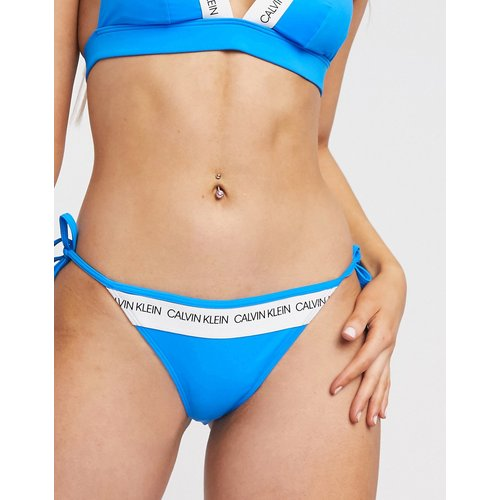 Bas de bikini à logo avec liens à nouer sur les côtés - Calvin Klein - Modalova
