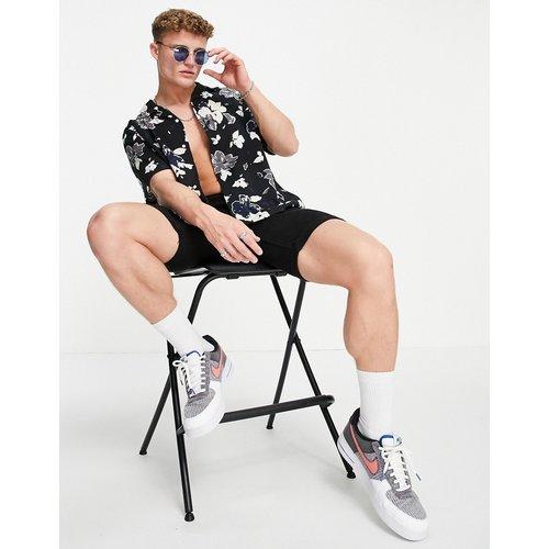 Chemise manches courtes avec col à revers et imprimé fleuri - Calvin Klein - Modalova