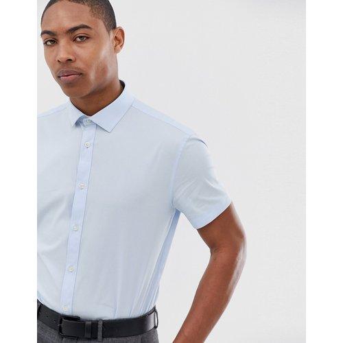 Chemise ajustée élégante à manches courtes - Celio - Modalova