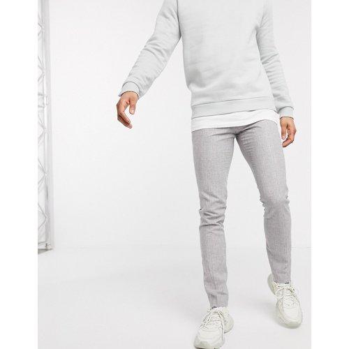 - Pantalon slim à carreaux - Celio - Modalova