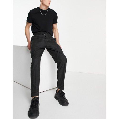 Pantalon slim à carreaux - Celio - Modalova