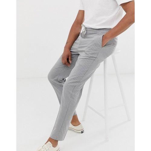 Pantalon slim à fines rayures - Celio - Modalova