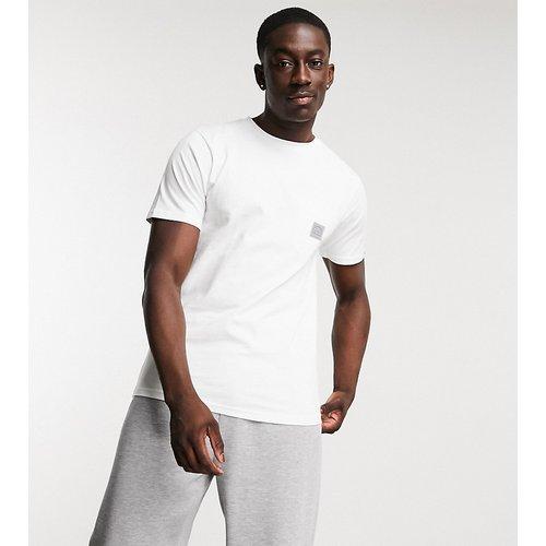 Exclusivité ASOS - T-shirt à poche - Ellesse - Modalova